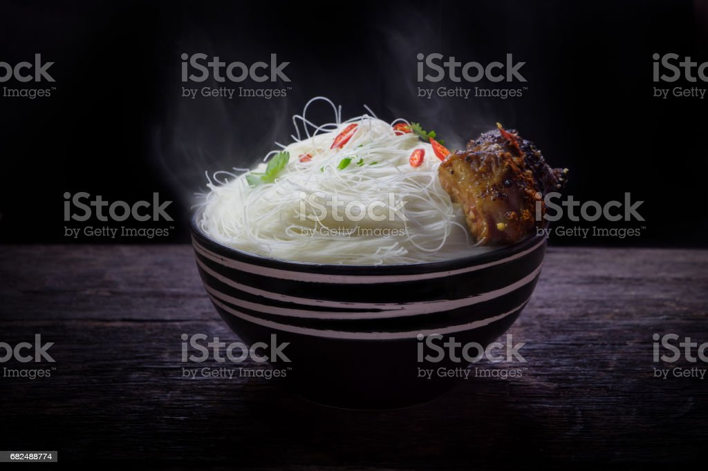 Instant vermicelli with roast pork spareribs in the bowl on wooden background royalty-free stock photo