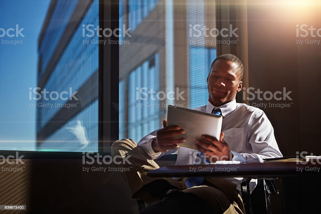 Instead of a notepad I take my tablet to meetings stock photo