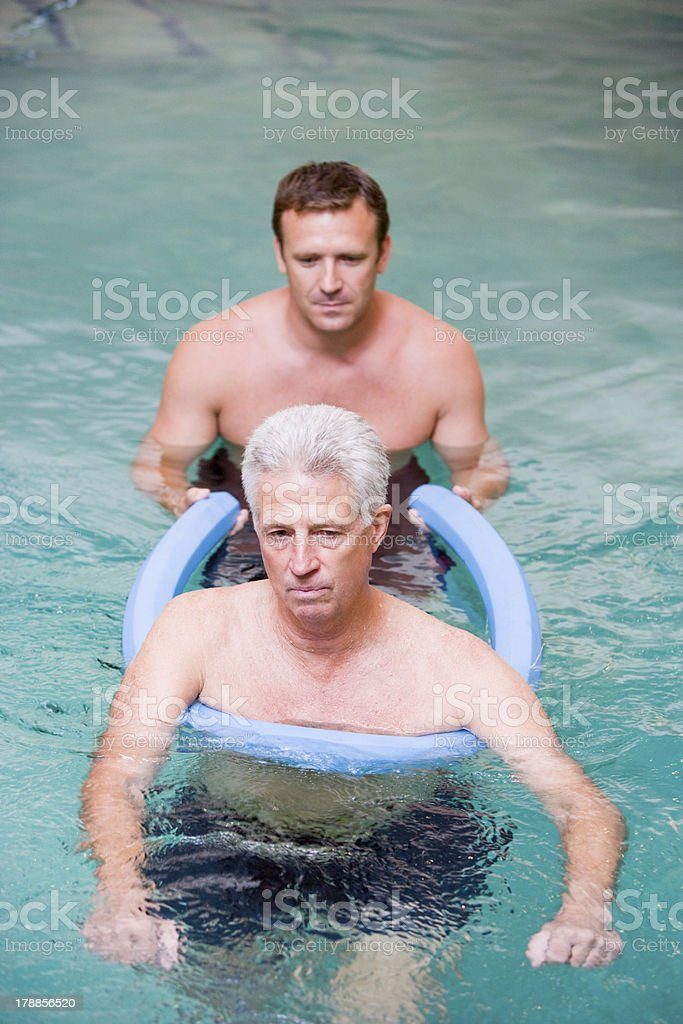Instructor And Patient Undergoing Water Therapy stock photo