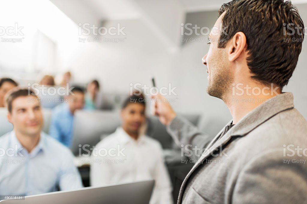 Instructor at a lecture. stock photo