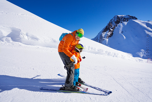 Instructor Give Ski Lesson To Little Boy Stock Photo - Download Image Now