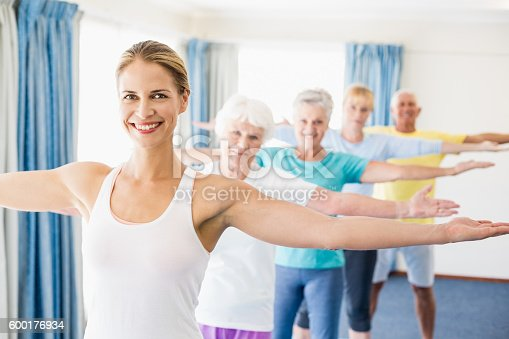 600177016 istock photo Instructor performing yoga with seniors 600176934