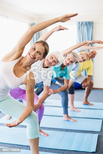 600177016 istock photo Instructor performing yoga with seniors 600176936
