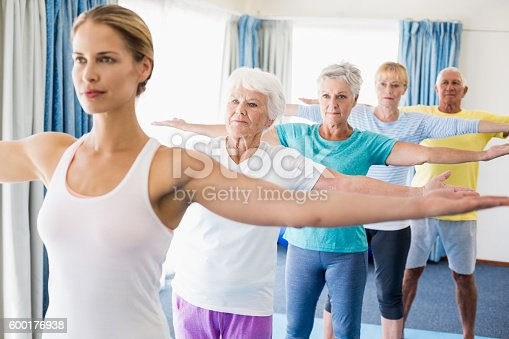 600177016 istock photo Instructor performing yoga with seniors 600176938