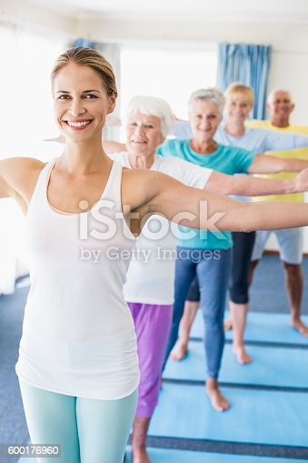 600177016 istock photo Instructor performing yoga with seniors 600176960