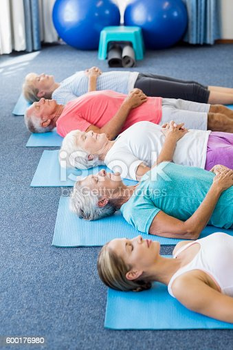 600177016 istock photo Instructor performing yoga with seniors 600176980