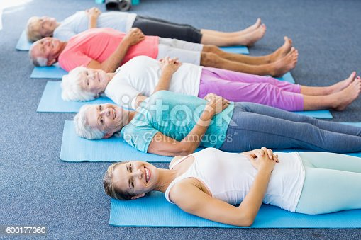 600177016 istock photo Instructor performing yoga with seniors 600177060