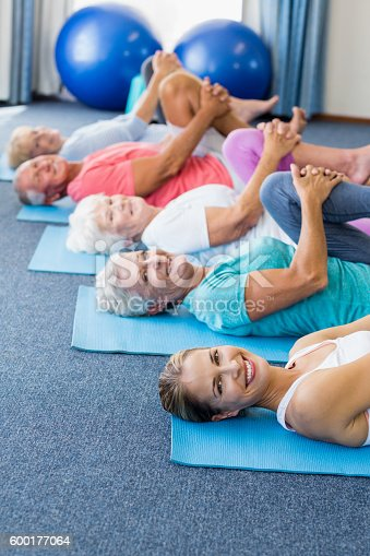 600177016 istock photo Instructor performing yoga with seniors 600177064