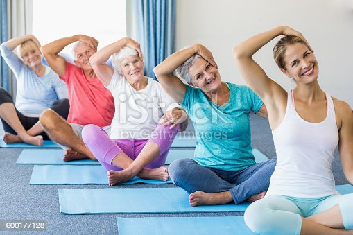 600177016 istock photo Instructor performing yoga with seniors 600177128