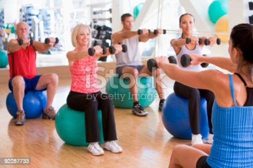 istock Instructor Taking Exercise Class At Gym 92287733