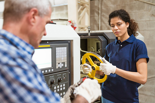 Instructor Teaching Apprentice In Industry Stock Photo - Download Image Now