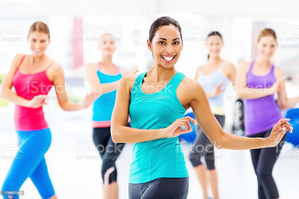Instructor With Customers Practicing Dance Fitness In Health Club royalty-free stock photo