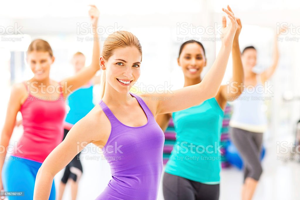 Instructor With Female Customers Practicing Dance Fitness In Gym royalty-free stock photo