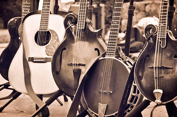 Instruments Are Ready 5 stringed instruments sit on a stage ready to be played. folk music stock pictures, royalty-free photos & images