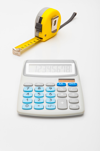 istock Instruments for measurement and calculating - yellow ruler and calculator 675062280