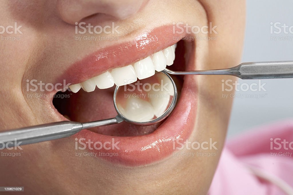 Instruments in mouth stock photo
