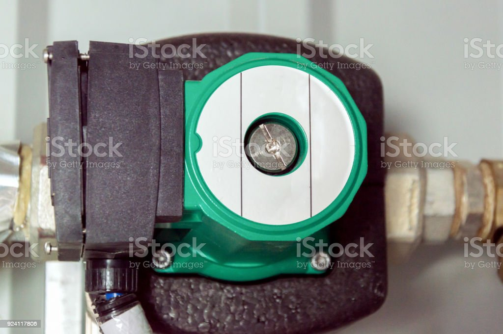 Insulated green circulation pump for glycol circuit of the air handling unit stock photo