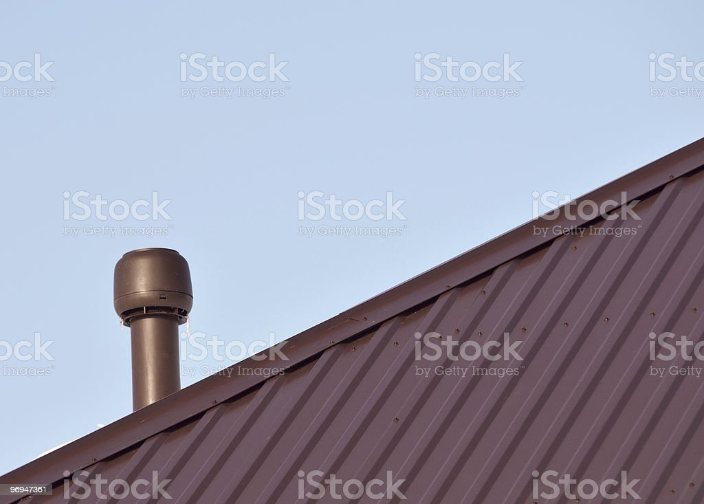 Insulated plastic ventilation pipe on the roof royalty-free stock photo