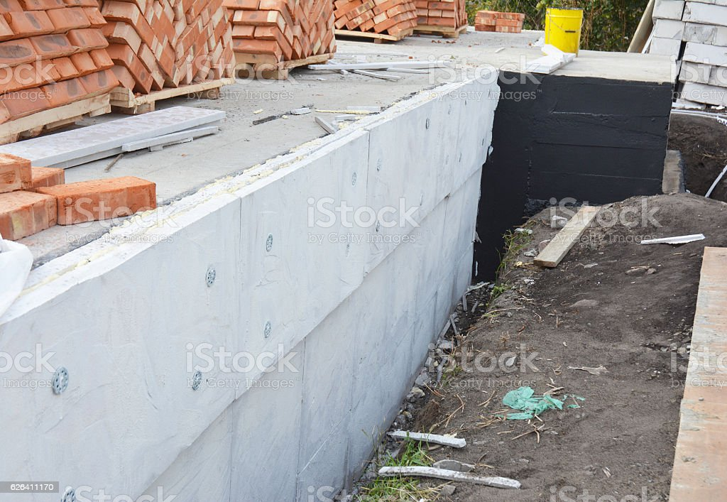Insulating Exterior Foundation Walls. Foundation Waterproofing and Damp proofing Coatings. stock photo