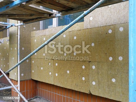 Facing the facade of house with mineral wool mats for insulation