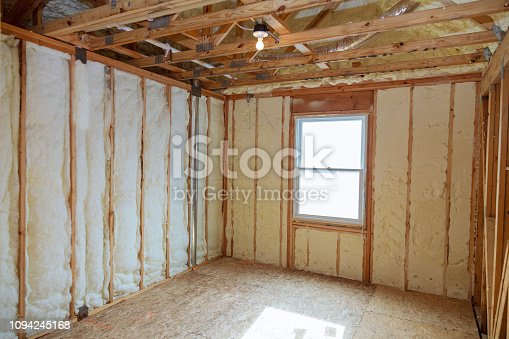 istock Insulation of attic with fiberglass cold barrier and insulation material 1094245168