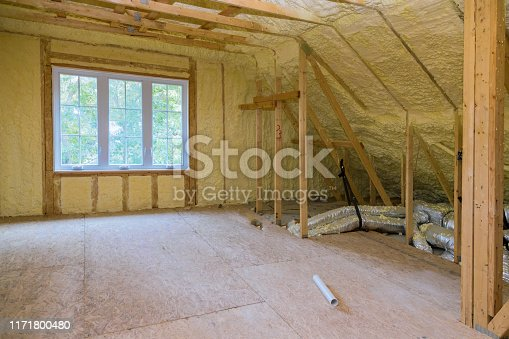 istock Insulation of thermal insulation attic with cold barrier and insulation material 1171800480