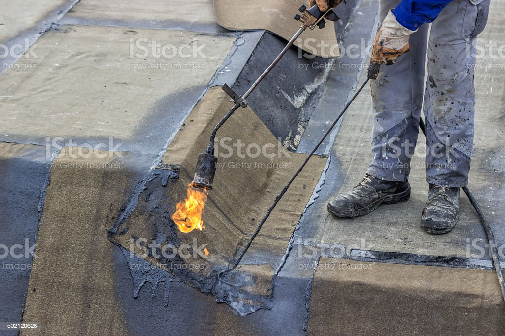 Insulation worker and propane blowtorch 2 stock photo