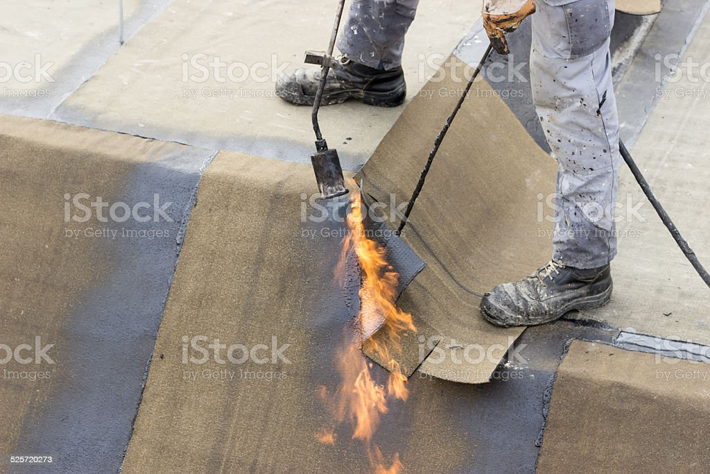 Insulation worker with propane blowtorch 2 stock photo