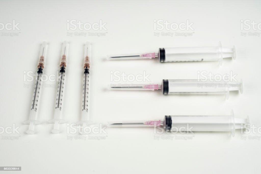 insulin and large syringe, white background. stock photo