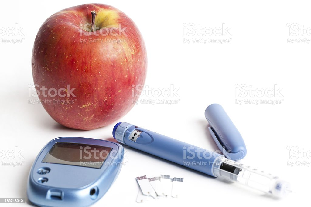 Insulin Pen, Test Strips & Glucometer with Apple royalty-free stock photo