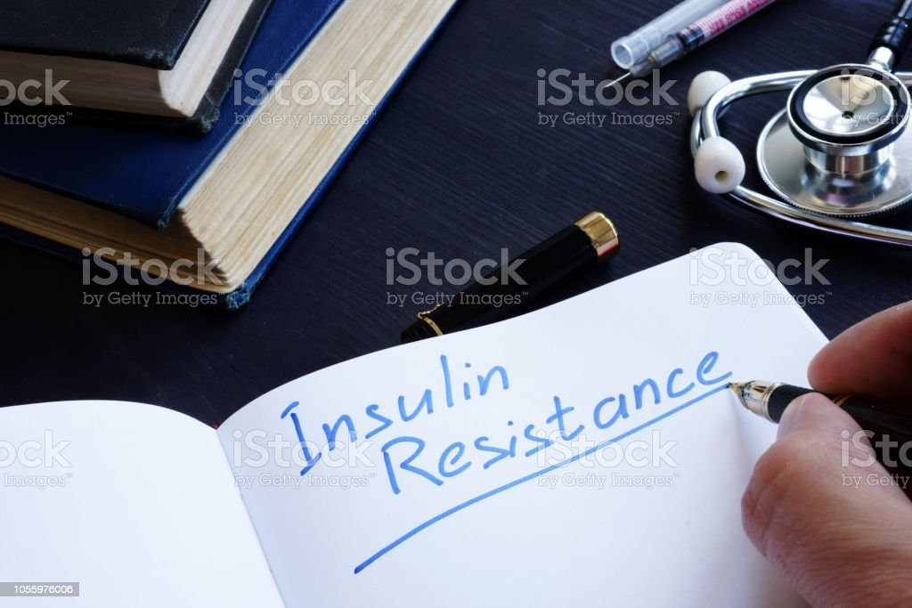 Insulin Resistance handwritten in a note pad. stock photo
