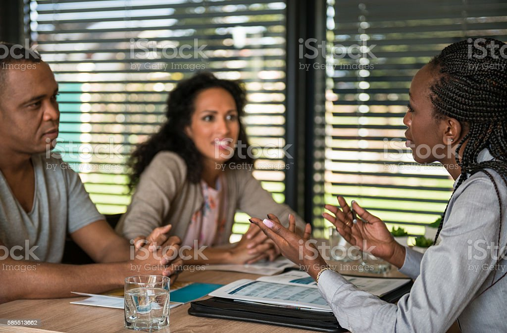 Insurace Agent Discussing With Couple stock photo