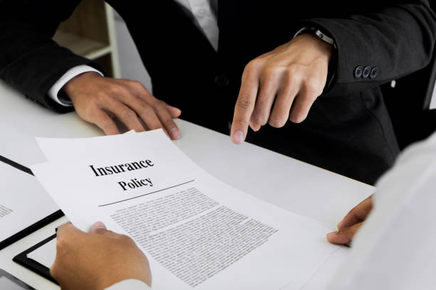 insurance agent explain consulting with customer to signing the policy form. - seguros imagens e fotografias de stock