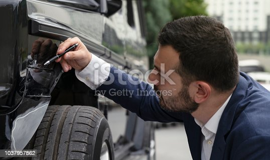 istock Insurance Agent Inspecting Damage On A Car 1037957862