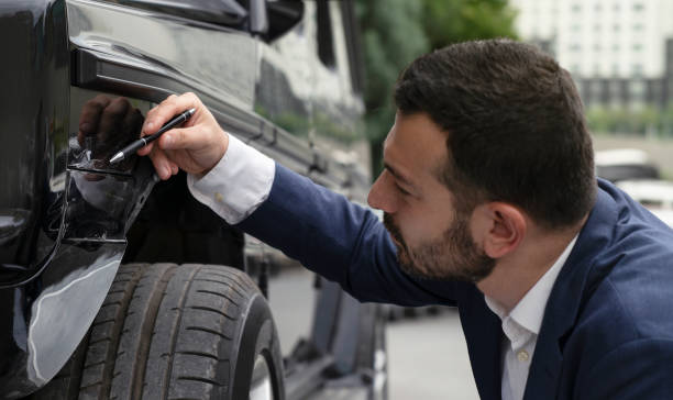 insurance agent inspecting damage on a car - dent stock pictures, royalty-free photos & images