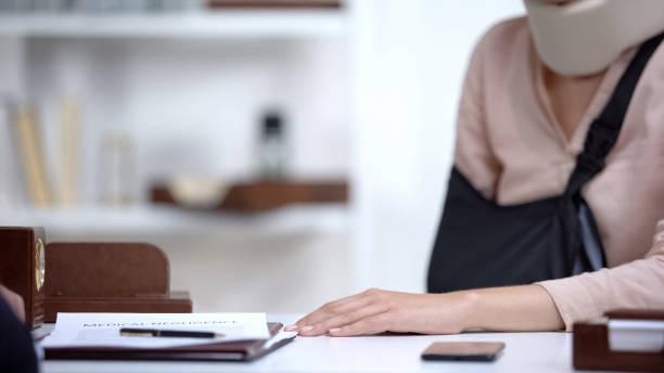 insurance agent regrets to inform victim about refusal to pay compensation - soddisfazione foto e immagini stock