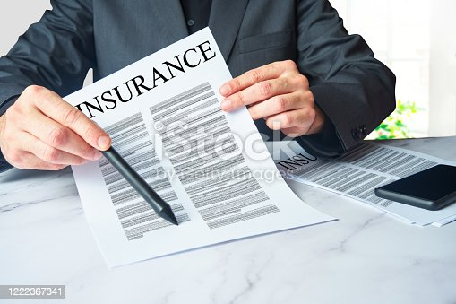 Insurance agent showing a contract to sign. Concept of medical, home, car, life and mortgage insurance concept