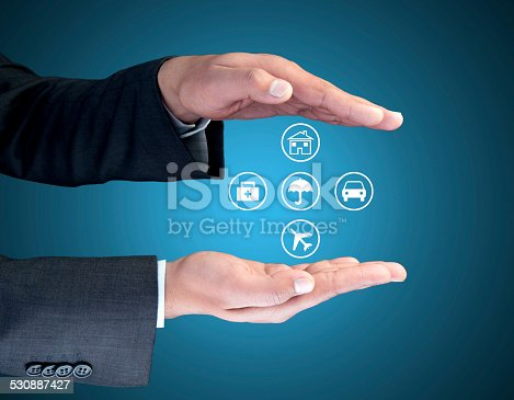 istock Insurance agent showing interface icons 530887427