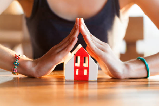 Insurance and house protection concept - foto stock