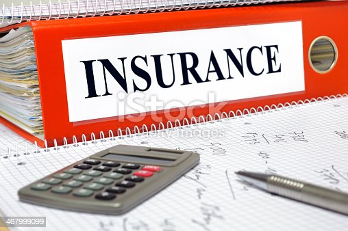 istock Insurance binder with calculator 467999099