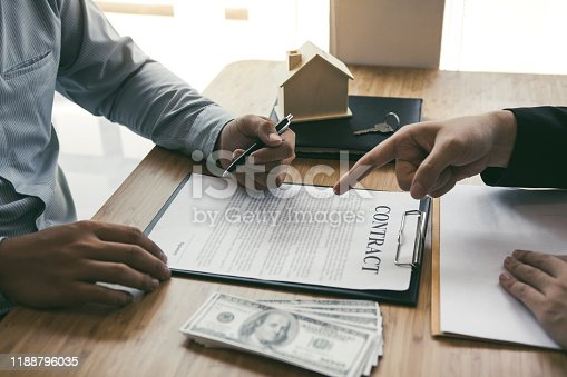 481337750 istock photo Insurance brokers are pointing to insurance contract signing and are explaining to customers at the office. 1188796035