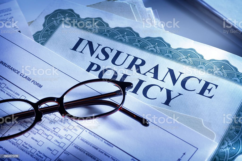 Insurance claim form and insurance policy stock photo