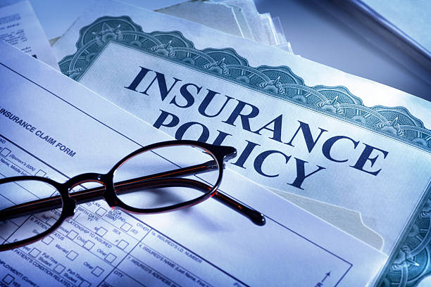insurance claim form and insurance policy - insurance stock photos and pictures