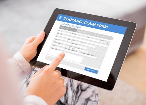 istock Insurance claim form 844020236