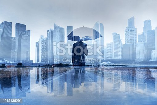 insurance concept, risk in business, businessman with umbrella double exposure