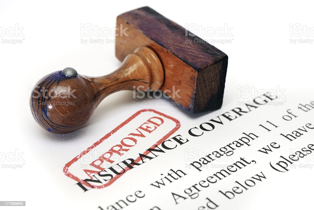 Insurance document with red approved stamp stock photo