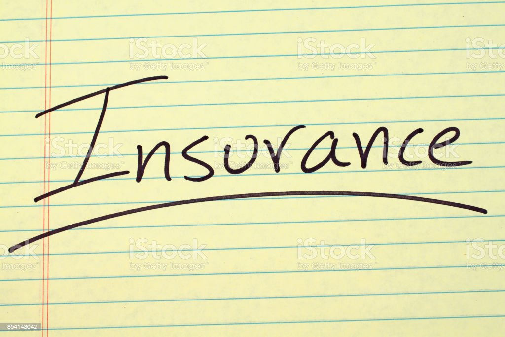 Insurance On A Yellow Legal Pad stock photo