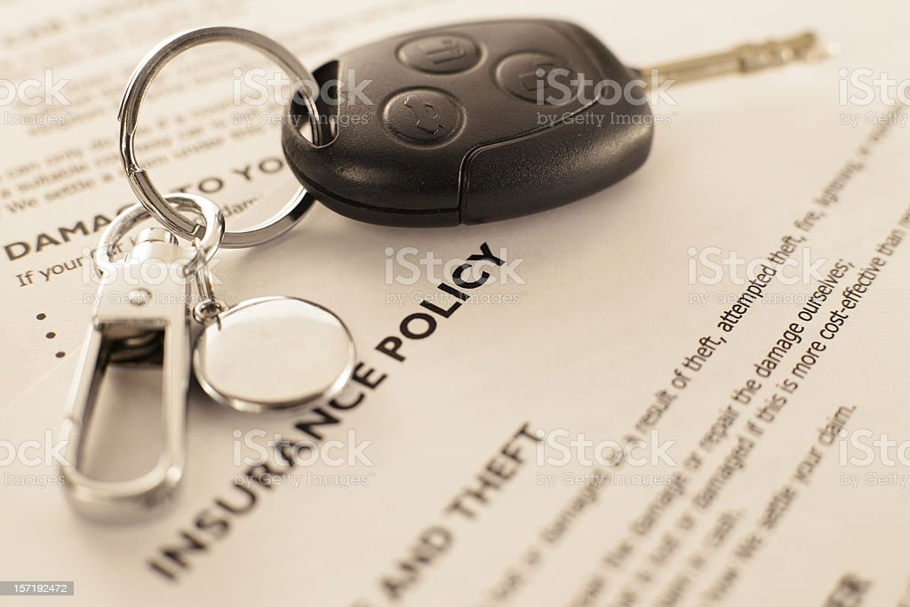 Insurance policy with car key royalty-free stock photo