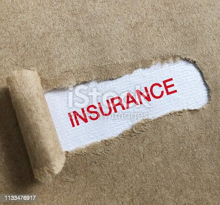 istock Insurance text on paper. 1133476917