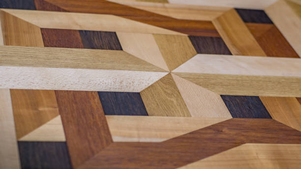 Intarsie parquet as parquet floor, design from several wood species, oak, maple, cherry tree, beech, ash Intarsie parquet as parquet floor, design from several wood species, oak, maple, cherry tree, beech, ash inlay stock pictures, royalty-free photos & images